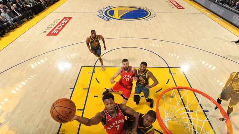 Kyle Lowry drives to the rim against Golden State