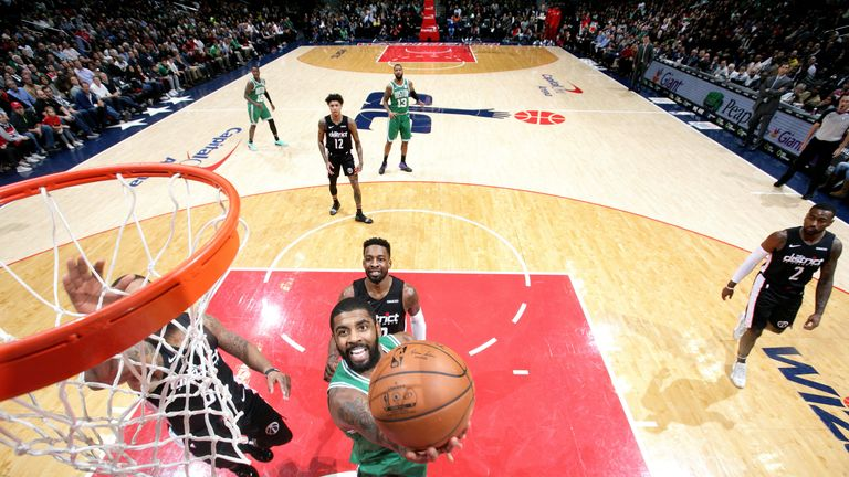 Kyrie Irving scores at the rim against Washington