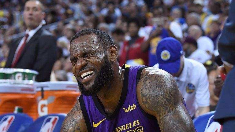 LeBron James reacts after leaving the game with a groin injury
