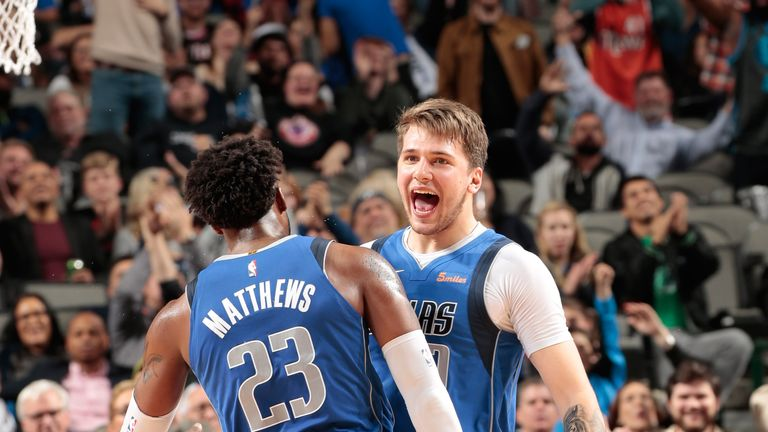Luka Doncic celebrates with team-mate Wesley Matthews