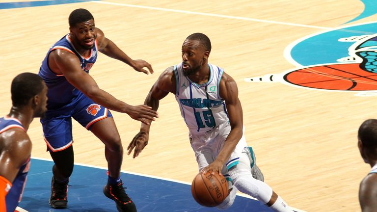 Kemba Walker dribbles into the Knicks' defense