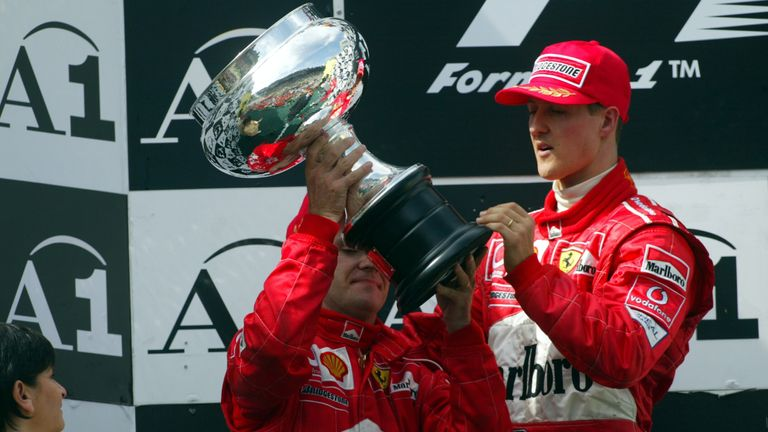 Schumacher won in controversial fashion after Barrichello ceded first position just yards from the line following Ferrari's orders. Schumacher won by 0.1s but even he was embarrassed, giving up the victory podium for his team-mate as the crowd booed.