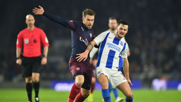Aaron Ramsey battles for possession with Pascal Gross