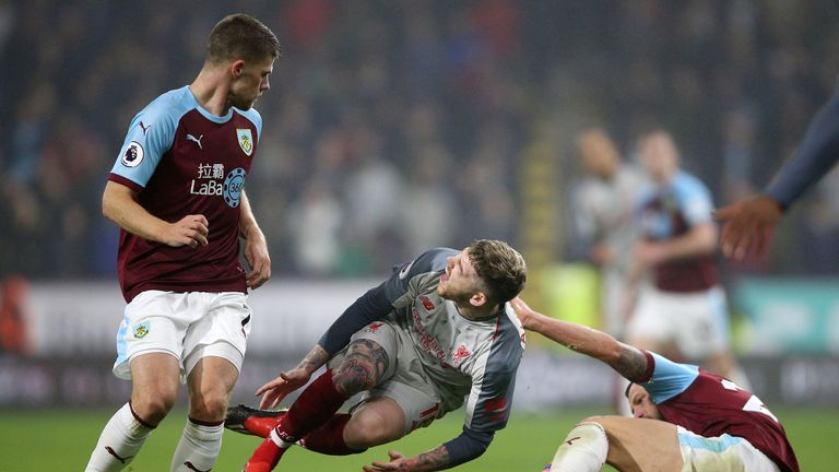 Alberto Moreno goes down under the challenge of Phil Bardsley