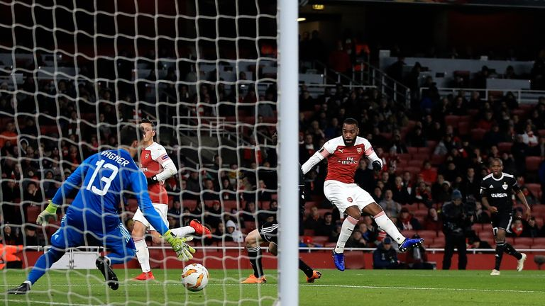 Alexandre Lacazette of Arsenal scores the opening goal of the game during the UEFA Europa League Group E match between Arsenal and Qarabag FK at Emirates Stadium on December 13, 2018 in London, United Kingdom