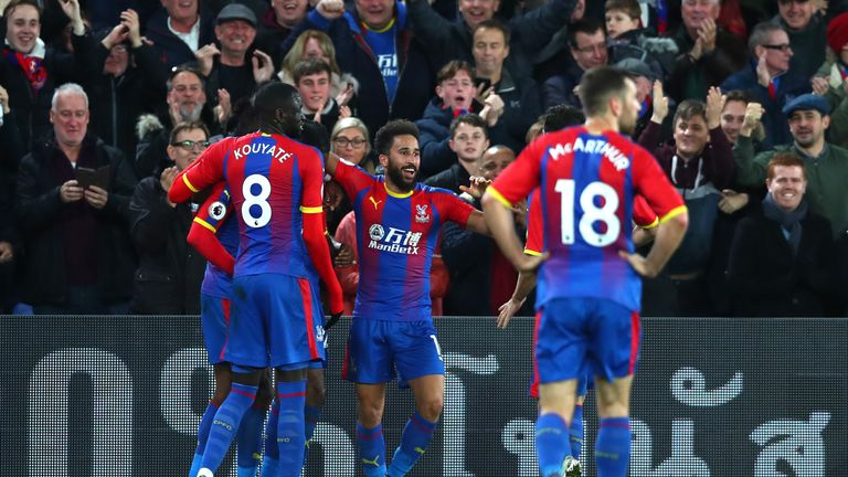 Andros Townsend of Crystal Palace celebrates with teammates after scoring his team's second goal during the Premier League match between Crystal Palace and Burnley FC at Selhurst Park on December 1, 2018 in London, United Kingdom.
