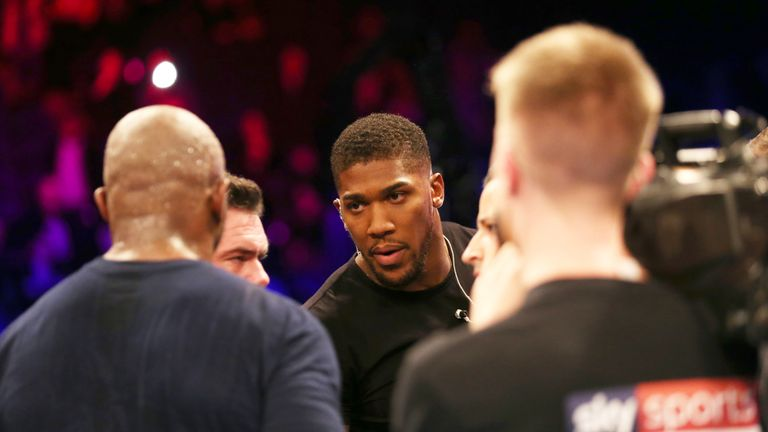 Anthony Joshua speaks with Dillian Whyte after the fight at the O2 Arena, London.