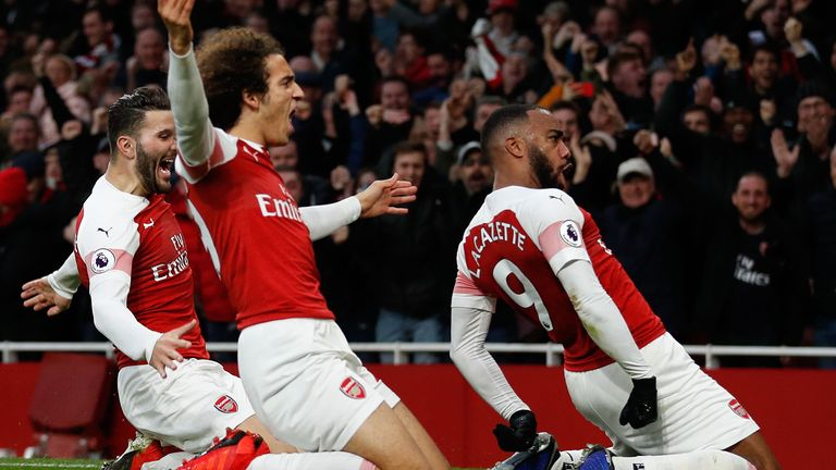 Alex Lacazette celebrates scoring the 3rd Arsenal goal with (L) Matteo Guendouzi and (R) Sead Kolasinac during the Premier League match between Arsenal FC and Tottenham Hotspur at Emirates Stadium on December 1, 2018 in London, United Kingdom.