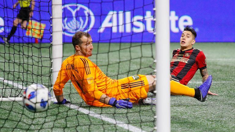 Franco Escobar scores Atlanta's second goal past goalkeeper Jeff Attinella
