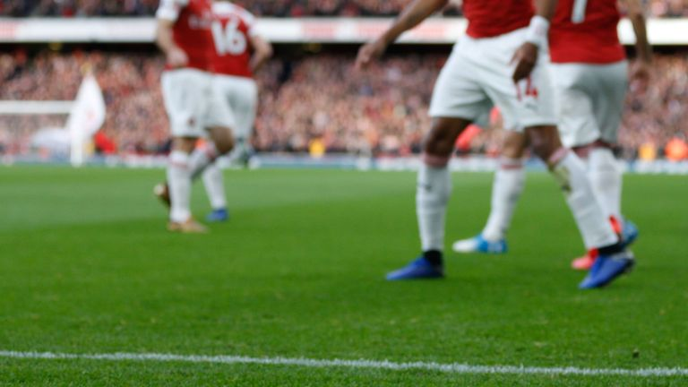A banana skin thrown from the crowd is seen on the pitch at the Emirates Stadium