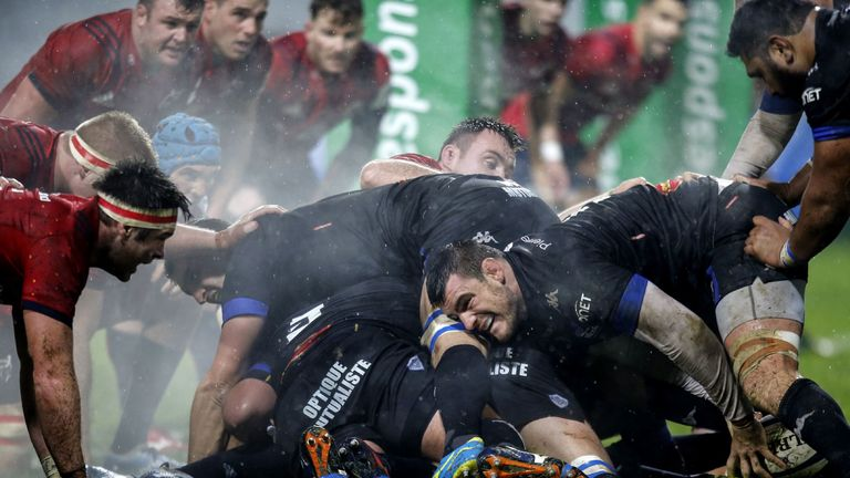 Thibault Lassalle grabs the ball at the base of a ruck as Castres hammer the Munster line