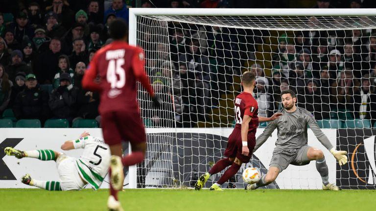 Celtic goalkeeper Craig Gordon makes a crucial save against RB Salzburg