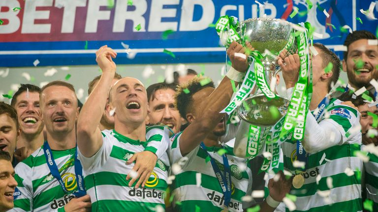 Celtic players celebrate with the Scottish League Cup