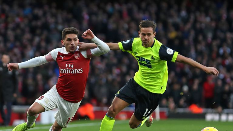 Chris Lowe battles for possession with Lucas Torreira