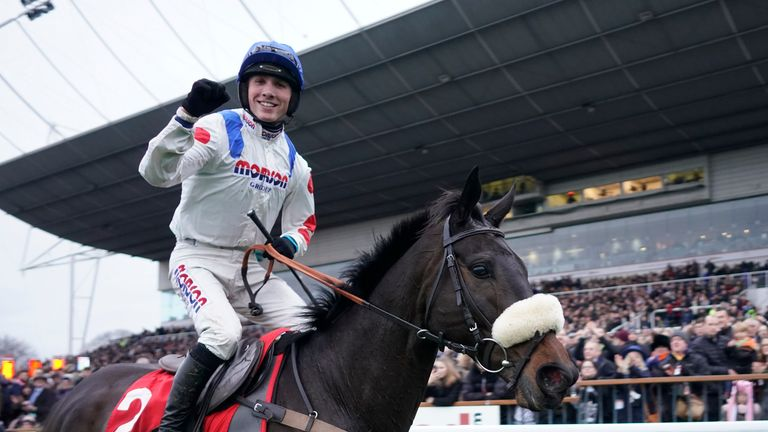 Harry Cobden celebrates after riding Clan des Obeaux to win The 32Red King George VI Chase at Kempton Park on December 26, 2018 in Sunbury, England
