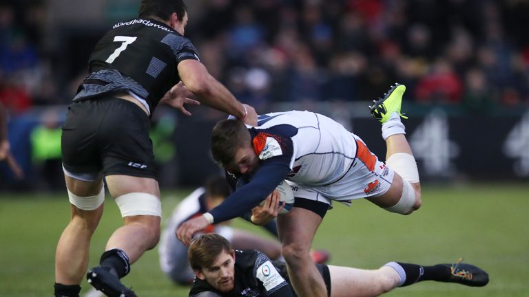Darcy Graham of Edinburgh Rugby is tackled by Newcastle's John Hardie