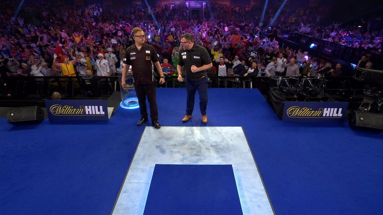 Wade celebrated in the face of Seigo Asada during his second-round win