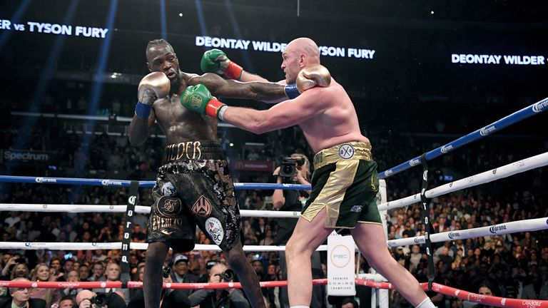 LDeontay Wilder and Tyson Fury punch each other in the ninth round fighting to a draw during the WBC Heavyweight Champioinship at Staples Center on December 1, 2018 in Los Angeles, California.  (Photo by Harry How/Getty Images)