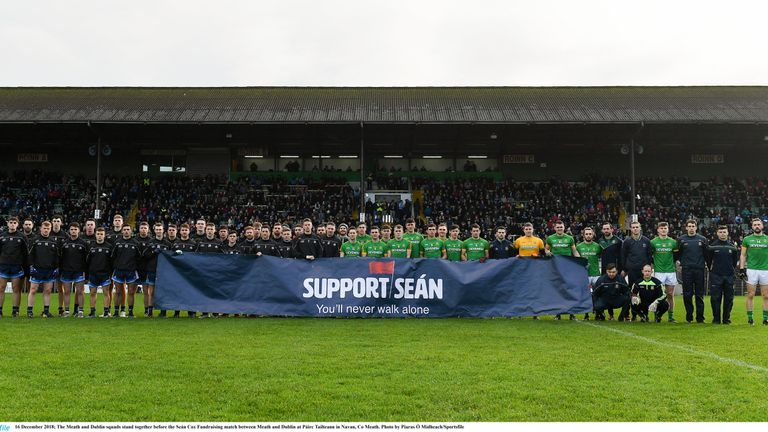 The Meath and Dublin squads stand together before the Seán Cox Fundraising match