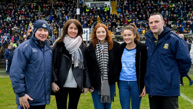 Dublin manager Jim Gavin and Meath manager Andy McEntee with the family of Sean Cox
