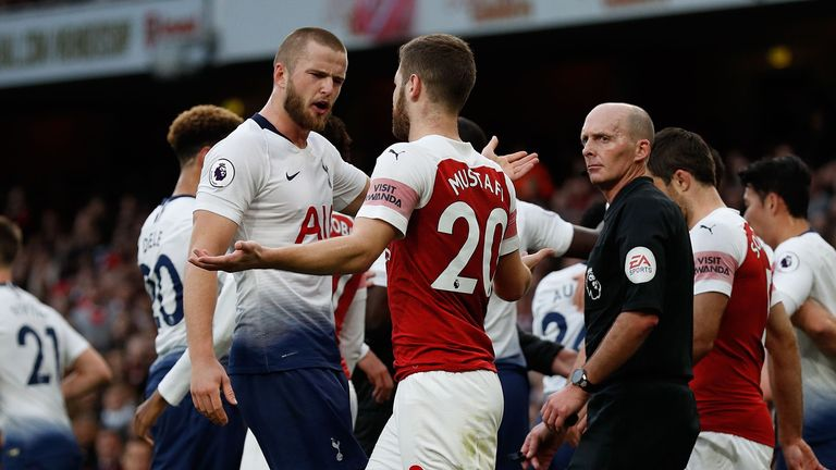 Eric Dier (centre left) and Shkodran Mustafi clash after Dier celebrates his equalizer