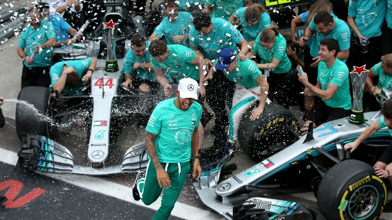 The Mercedes team celebrate wrapping up a fifth consecutive Constructors' Championship title following Lewis Hamilton's victory in the Brazilian GP. Picture by Charles Coates, Getty Images.