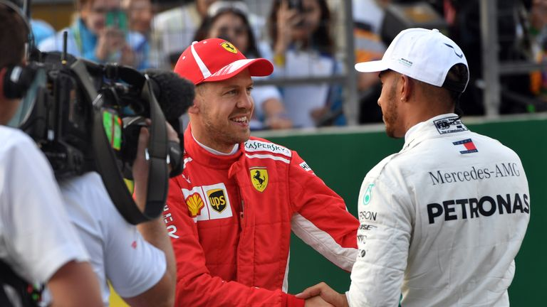 A year on from their clash in Baku, Lewis Hamilton and Sebastian Vettel share a handshake after Azerbaijan GP qualy. Despite an intense fight for the title, Hamilton and Vettel remained respectful rivals. Pictures by Andrej Isakovic, Getty Images.