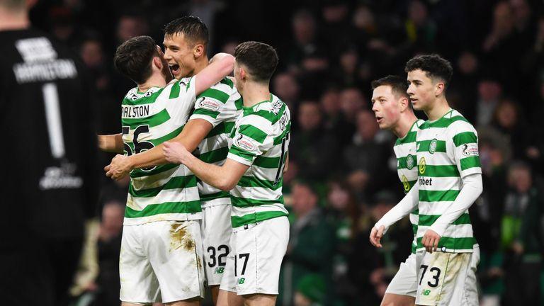 Celtic's Filip Benkovic celebrates after scoring to make it 3-0