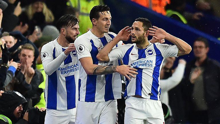 Substitute Florin Andone (R) celebrates scoring Brighton's third goal