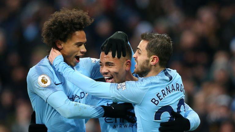 Gabriel Jesus celebrates with Leroy Sane and Bernardo Silva