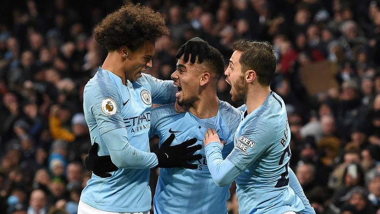 Gabriel Jesus celebrates his first goal with Leroy Sane and Bernardo Silva