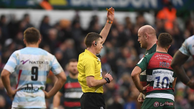 Referee George Clancy issues a yellow card to Tigers prop Dan Cole
