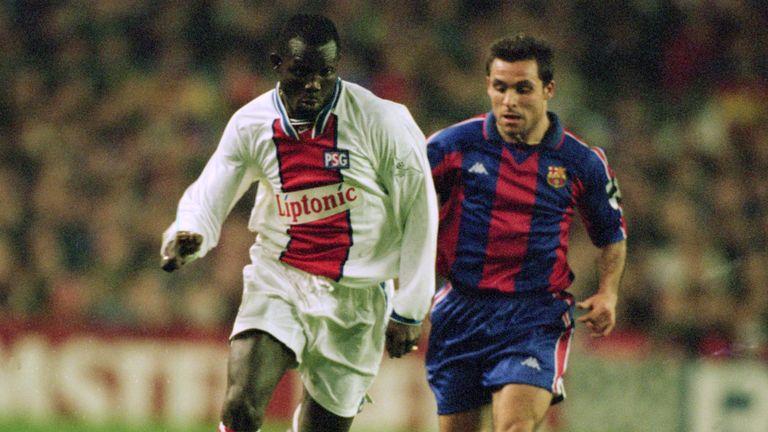 George Weah in action for Paris St Germain against Sergi of Barcelona in 1995