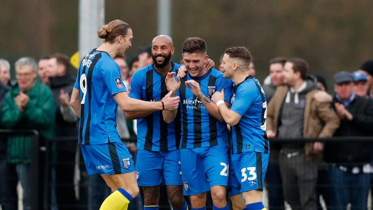 Gillingham celebrate Darren Oldaker's goal during their win over Slough Town