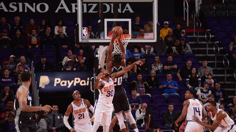 Harry Giles #20 of the Sacramento Kings dunks the ball against the Phoenix Suns on December 4, 2018 at Talking Stick Resort Arena in Phoenix, Arizona