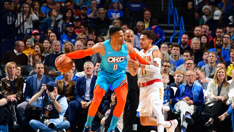 OKLAHOMA CITY, OK- NOVEMBER 30: Russell Westbrook #0 of the Oklahoma City Thunder handles the ball against Trae Young #11 of the Atlanta Hawks on November 30, 2018 at Chesapeake Energy Arena in Oklahoma City, Oklahoma. NOTE TO USER: User expressly acknowledges and agrees that, by downloading and or using this photograph, User is consenting to the terms and conditions of the Getty Images License Agreement. Mandatory Copyright Notice: Copyright 2018 NBAE (Photo by Scott Cunningham/NBAE via Getty Images)