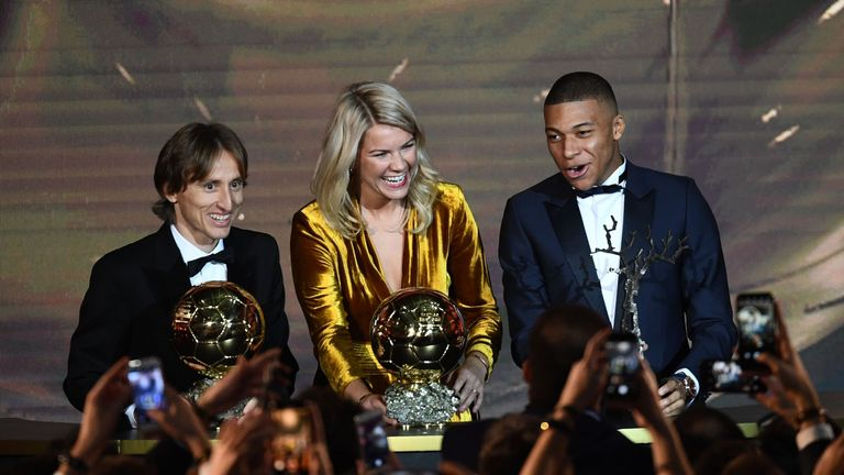 Ada Hegerberg (centre) collected the Ballon d'Or alongside Luka Modric (left) and Kylian Mbappe
