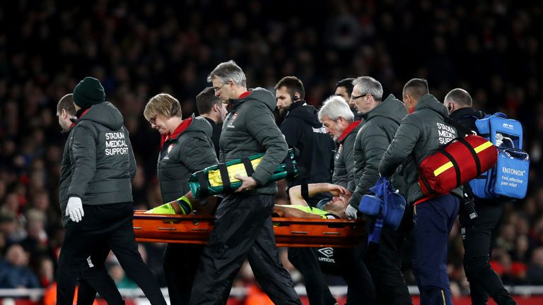 Tommy Smith was stretchered off during Huddersfield's defeat at Arsenal