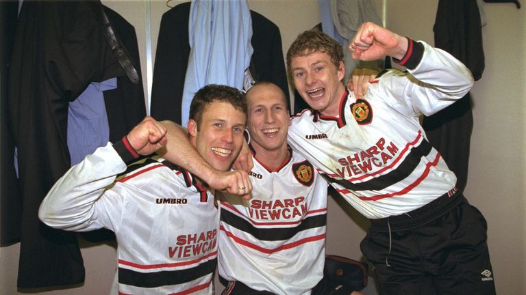 Jaap Stam, Ole Gunnar Solskjaer and Ronny Johnson of Manchester United celebrate in the dressing room after the FA Cup semi-final between Arsenal v Manchester United at Villa Park on April 4, 1999.