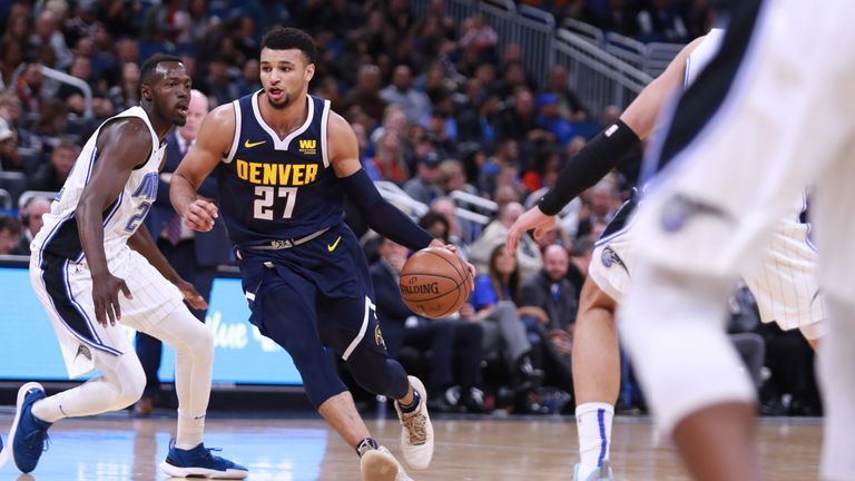 Jamal Murray #27 of the Denver Nuggets drives down the court against the Orlando Magic in the first half at Amway Center on December 05, 2018 in Orlando, Florida.