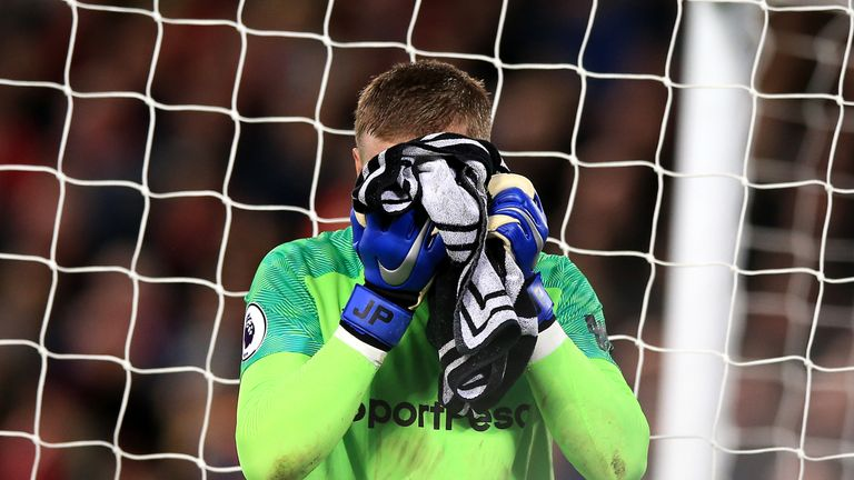Everton goalkeeper Jordan Pickford reacts during the Premier League match at Anfield, Liverpool