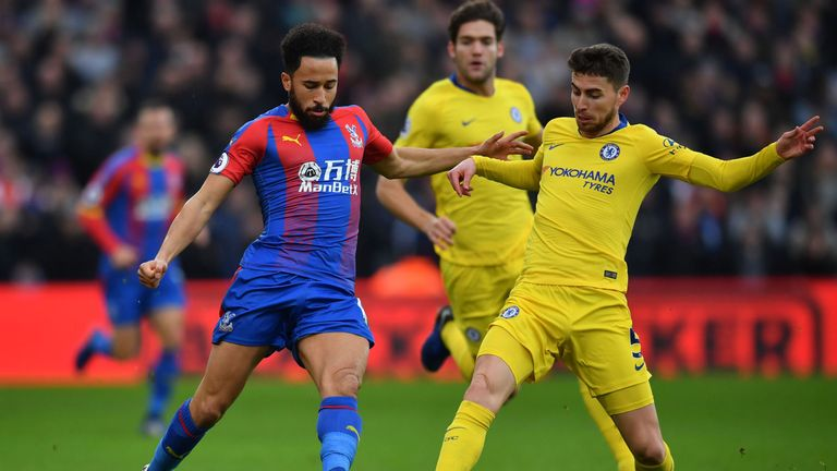 Jorginho challenges Andros Townsend for possession
