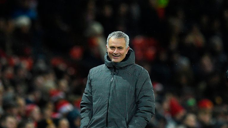 Manchester United's Portuguese manager Jose Mourinho laughs on the touchline during the English Premier League football match between Manchester United and Manchester City at Old Trafford in Manchester, north west England, on December 10, 2017