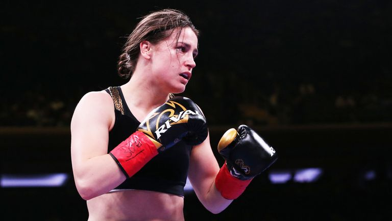 Katie Taylor defended her world titles with a one-sided points win