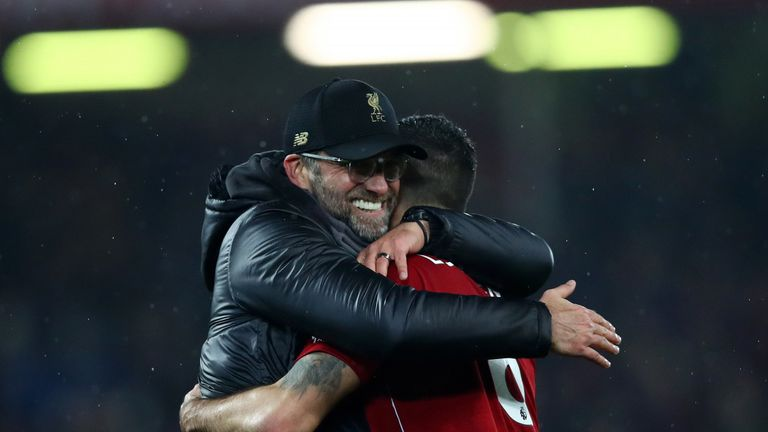 Jurgen Klopp and Dejan Lovren during the Premier League match between Liverpool FC and Manchester United at Anfield on December 16, 2018 in Liverpool, United Kingdom.