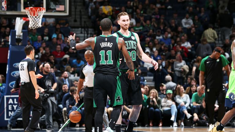 Kyrie Irving #11 greets Gordon Hayward #20 of the Boston Celtics during the game against the Minnesota Timberwolves on December 1, 2018 at Target Center in Minneapolis, Minnesota.