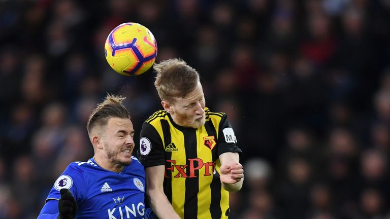 Leicester's James Maddison competes for a header with Watford's Will Hughes
