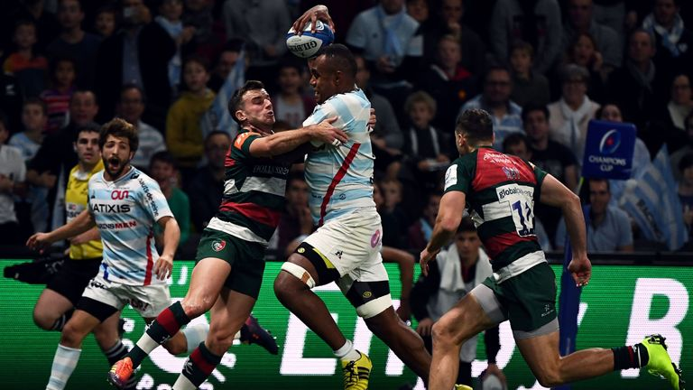Racing's  Leone Nakarawa takes on Leicester's George Ford
