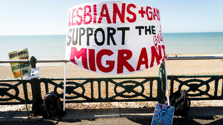 BRIGHTON, ENGLAND - AUGUST 06: A sign in support of migrants is displayed on the seafront ahead of the Brighton Pride Parade on August 6, 2016 in Brighton, England. (Photo by Tristan Fewings/Getty Images)