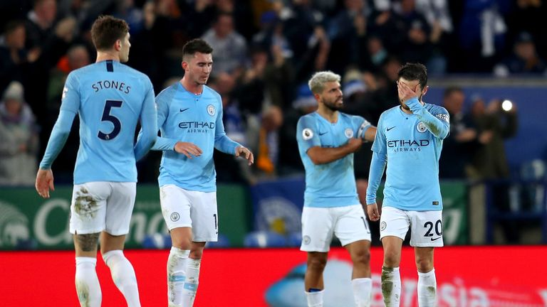 Manchester City's players cut dejected figures during the 2-1 defeat to Leicester City